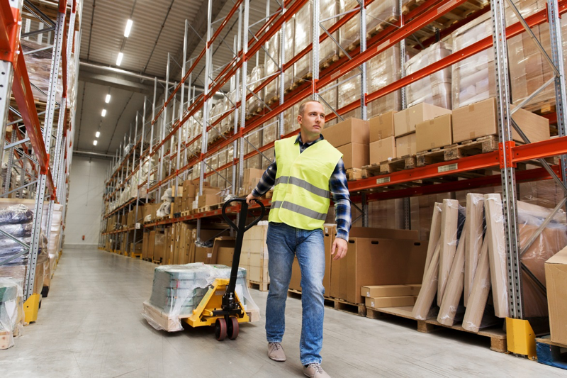 Man move pallet in warehouse